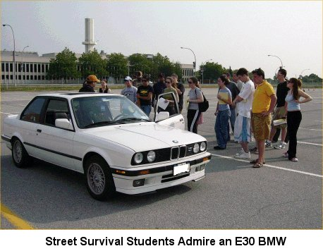 [Street Survival Students Admire an E30 BMW]