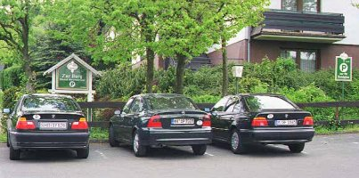 [Chet's 316i, Charles Vectra, and My 520i at Hotel Zurburg]